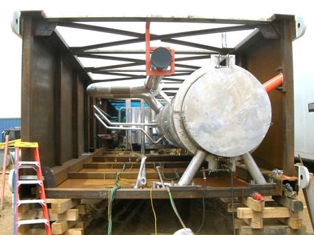 End view of cold box module being prepared for erection. Note column, heat exchanger, temporary supports (red).