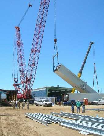 Raising the first ASU cold box module to the vertical.  Tailing crane supports bottom of module.