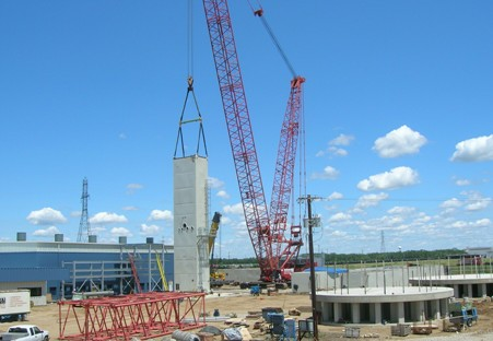 First ASU module being set on founation. Compressor building to the rear.  Liquid storage tank foundations in foreground.