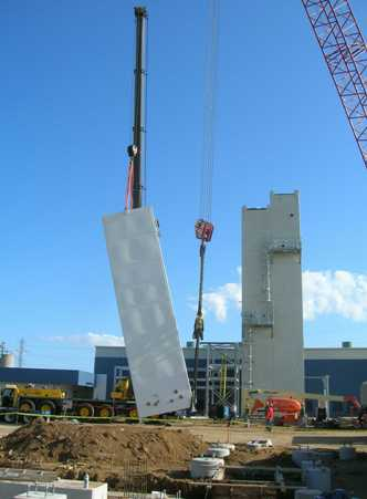 Liquefier (NLU) cold box approaches vertical.  Note that smaller crane is lift crane, large crane is tailing crane.
